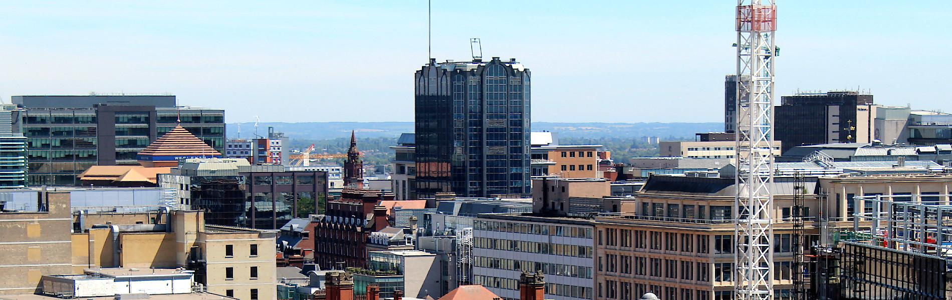 Photograph of the Birmingham City Centre skyline against a brilliant blue sky.