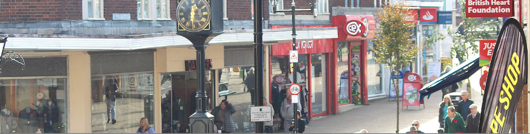 A row of shops in Halesowen Town Centre on a busy afternoon.
