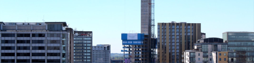 A picture of the skyline of Birmingham city centre against a blue sky.